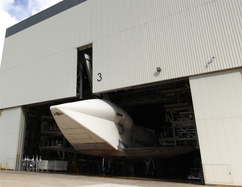 Space Shuttle in Hanger for Repairs & Maintenance
